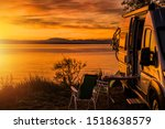 Class B Motorhome RV and the Scenic Sea Front Sunset. Road Trip Camping. Recreation Vehicle Theme. - stock photo