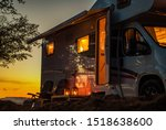 Scenic RV Camping Spot During Sunset. Class C Motorhome Camper Van. Travel Industry Theme. - stock photo