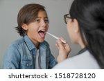 Female Pediatrician Using...
