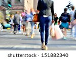 Zoom and motion blurred crowd crossing street. Blur effects made in lens, not post processing. - stock photo
