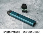 Small photo of Vape pod system or pod mod with changeable cartridges close up - newest generation of vaping products - small size devices for inhaling higher nicotine strengths