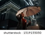 A girl with a large umbrella at ...