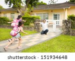 Happy Father With Kids In Fron...