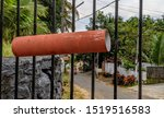 Small photo of A small piece of pipe which is connected to the front Gates of homes so that newspaper or mails could be dropped in. these strange mail box ideas are found in abundance in Kerala, India Sep 2019
