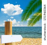 Tropical beach with empty wooden sign - Vacation concept - stock photo