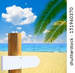 Empty wooden sign on tropical paradise beach - stock photo