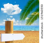 Paradise beach with empty wooden sign - Vacation cocnept - stock photo