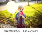 Cute Little Girl Holding A Big...
