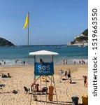 Small photo of Donostia San Sebastian, Basque Country, Spain, September, 29, 2019: Lifeguard post on Donostia San Sebastian beach with yellow flag.