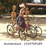 Three Bicycle Skeletons Dressed ...