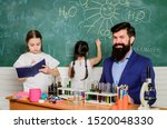 Stock photo discover and explore properties of substances together school club education teacher and pupils 1520048330