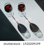 Two Glasses Of Red Wine On A...