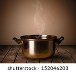 cooking pot on old wooden table | Shutterstock . vector #152046203