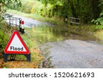 Flooded Country Road In Englan...