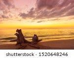 Couple On Beach At Sunset...
