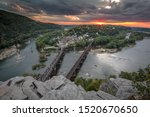 View of Harpers ferry from overlook point at Maryland Height trails during a sunset period