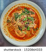 Small photo of Spicy Mee Bandung Malaysia. Served with egg half-cocked, tomatoes, prawns, vegetables