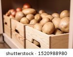 crates with potatoes on shelf ...