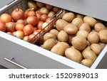 open drawer with potatoes and...