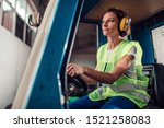 Woman Forklift Operator Driving ...