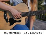 Girl\'s Hand Plays The Acoustic...
