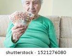A Senior Woman Looking To Euro...