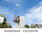tower crane lifting small... | Shutterstock . vector #152132234