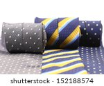 Three rolled up neckties. - stock photo