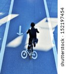 Man on bike in the evening - stock photo
