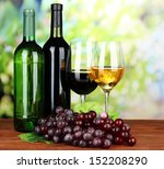 Wine Bottles And Glasses Of...
