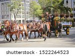 Small photo of MUNICH, GERMANY - SEPTEMBER 22, 2019 Grand entry of the Oktoberfest landlords and breweries, festive parade of magnificent decorated carriages and bands. Hacker-Pschorr brewery carriage
