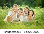 happy family in the green... | Shutterstock . vector #152232023