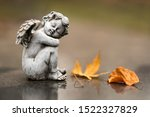 Small Angel Statue As Grave...