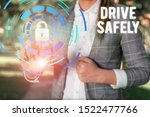 Small photo of Text sign showing Drive Safely. Conceptual photo you should follow the rules of the road and abide laws Female human wear formal work suit presenting presentation use smart device.