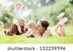 joyful family of four enjoying... | Shutterstock . vector #152259596