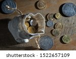 Old antique coins and medals .Bonistics and numismatics collection.Magnifying glass.Russian Empire and world old money.Silver,gold.Treasure hood concept. Vintage and retro style.