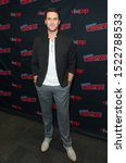 Small photo of New York, NY - October 3, 2019: Owain Yeoman attends presser for ABC Emergence series during New York Comic Con at Jacob Javits Center