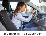 Small photo of Stressed woman drive car feeling sad and angry. Asian girl tired, fatigue mental on car. Sleepy and drunk female hangover. Illegal law driver license. Driving when tired and don't drive drowsy concept