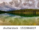 Panoramic view. Unbeatable Beauty of Banff National Park in Alberta Canada. Herbert Lake early in the morning or during sunset to enjoy incredible reflection of Mt. Temple.