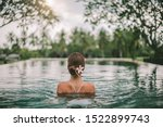 Small photo of Young girl swimming in infinity pool with in private villa resort. Travelling to Ubud, Bali.