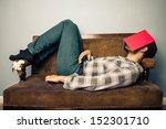 man sleeping on old sofa with