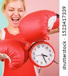 Small photo of Improve yourself. Overcome harmful habits. Time for training. Get used to personal regime. Girl athlete boxing gloves and alarm clock. Sport lifestyle and healthy regime. Habits and regime concept.
