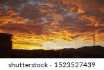 Orange and yellow clouds during sunset in Pasto city in the south of Colombia.