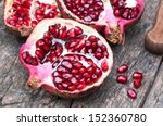 Juicy Pomegranates On Wood