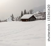 Old Barn On Snowy Field In The...
