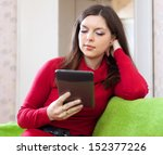 young woman reads e reader or... | Shutterstock . vector #152377226