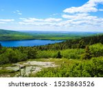 Photo/view of beautiful landscape of lakes and fields from Cadillac Mountain in Acadia National Park, Maine