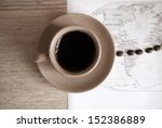 artwork  in grunge style,  cup of coffee, coffee beans and political map of the world