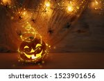Stock photo holidays halloween concept image pumpkin spiders over wooden table 1523901656