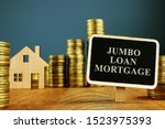 Jumbo Loan mortgage inscription and stacks of coins.